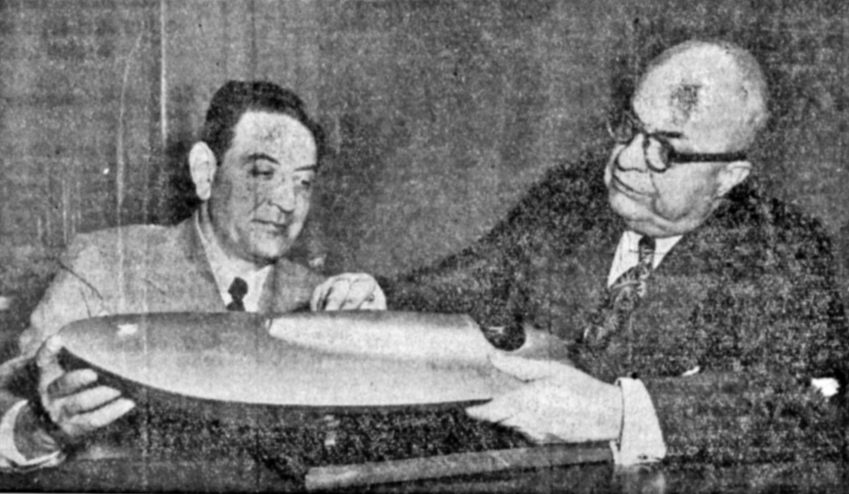 Guy Lombardo and Henry Kaiser examine a model of the Aluminum First