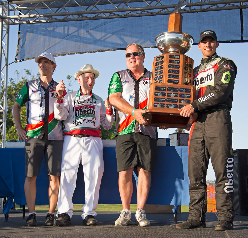 Art Oberto, Larry Oberto and Jimmy Shane accepting the trophy