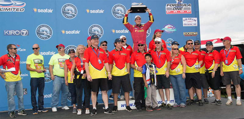 Andrew Tate hoists the Seafair Trophy